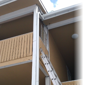 Gutter System with a Ladder