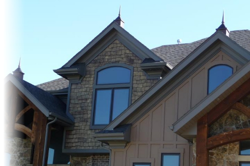 Brown House with a Custom Crown Roof